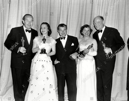 "Crawford Oscar winners pose with their statuettes at the 22nd Annual Academy Awards presentation in Hollywood, Ca., on . Standing from left to right are, Broderick Crawford, best actor in ""All the King's Men""; Olivia de Havilland, best actress in ""The Heiress""; Robert Rossen, producer of best motion picture, ""All The King's Men""; Mercedes McCambridge, best supporting actress in ""All the King's Men""; and Dean Jagger, best supporting actor in ""Twelve O'Clock High"