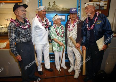 GOODYEAR World War II veterans, from left, Edward Vezey, Jr., 84, of Center, Colo., 80, George Smith, 80, of Tenino, Wash., and George Brown, 83, of Honolulu, Jerry Tessaro, 86, of Stockton, Calif., and Paul Goodyear, 86, of Casa Grande, Ariz., stand in front of the newly unveiled USS Oklahoma exhibit at the Arizona Memoiral Museum in Pearl Harbor, Hawaii, Monday, Dec. 6. 2004. Both Smith and Brown were aboard the ship that was hit by as many as nine japanese torpedoes on . Within 20 minutes the old battleship rolled almost completely over, trapping hundreds of sailors in the ship's hull