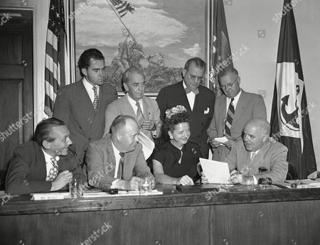 Members of House Committee on Un-American Activities pose with Elizabeth T. Bentley before start of her testimony in Washington, . Front, left to right: Rep. John McDowell (R-Pa.), Karl E. Mundt (R-ND), Bentley, confessed former Communist agent, and committee chairman J. Parnell Thomas (R-NJ). Back: Reps. Richard M. Nixon (R-Calif.), John Rankin (D-Miss.), F. Edward Hebert (D-La.) and J. Hardin Peterson (D-Florida