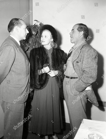 Roberto Rossellini, Joan Caulfield, Frank Capra Italian film director Roberto Rossellini, (Paisan and Open City) was guest of honor at a luncheon in Paramount Studios in Hollywood on marking his first visit to this country. Rossellini, left, is show at the luncheon with actress Joan Caulfield and director Frank Capra, three time winner of the coveted Academy Award, who was host