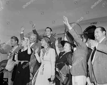 Wayne Morris, Jean Muir, Binnie Barnes, Lucille Gleason, Ralph Morgan, Edward Arnold, Larry Steers, Mischa Auer A delegation of movie actors, members of the Screen Actors Guild, wave on arrival at Newark, N.J., in a chartered plane en route to Atlantic City to participate in a jurisdictionanl dispute between actors' unions. Front, from left: Wayne Morris, Jean Muir, Binnie Barnes, Lucille Gleason, Ralph Morgan, Edward Arnold. Back row, from left: Larry Steers, Mischa Auer