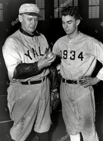 "Stock Photo of Joe Wood, Tad Jones, Jr Coach Joe Wood, of Yale, left, talks to one of his most promising 1935 baseball prospects, none other than Tad Jones, Jr., son of the late Yale coach in New Haven, Connecticut, . Young Jones is a twirler, and coach Wood says he's got ""a lot of stuff on the ball"
