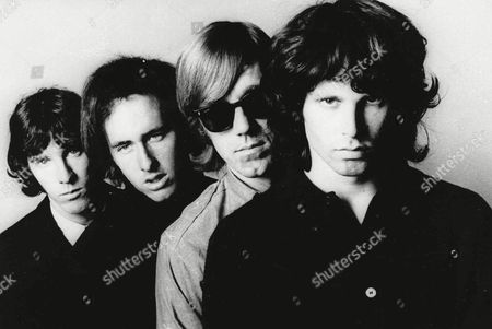 MANZAREK Members of the Doors pose for an undated publicity photo. From left; John Densmore, Robbie Krieger, Ray Manzarek and Jim Morrison. Morrison died in 1971 at age 27. A four-CD boxed set of Doors material has been released, breaking sales records for boxed sets this year in its first week of release, according to Electra Records