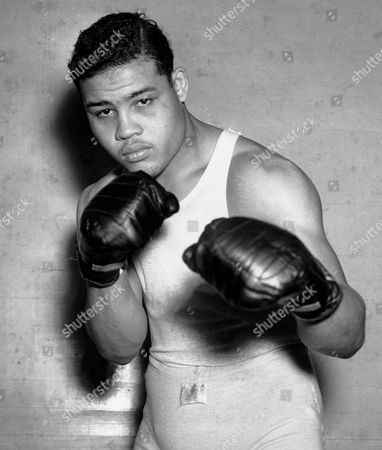 "Stock Image of JOE LOUIS Boxer Joe Louis, nicknamed the Brown Bomber, posing in Pompton Lakes, N.J. Louis captures the world heavyweight title in June 1937 and held it until May 1949. The producing team behind Broadway shows about Vince Lombardi, the Yankees, and Earvin ""Magic"" Johnson and Larry Bird have just gotten the rights to tell the story of boxing great Joe Louis. Fran Kirmser and her producing partner Tony Ponturo said, that they have acquired the exclusive global, theatrical and movie rights to Louis' life story. If they turn it into a stage story, Ponturo and Kirmser will have their fourth sports-related play since 2010"