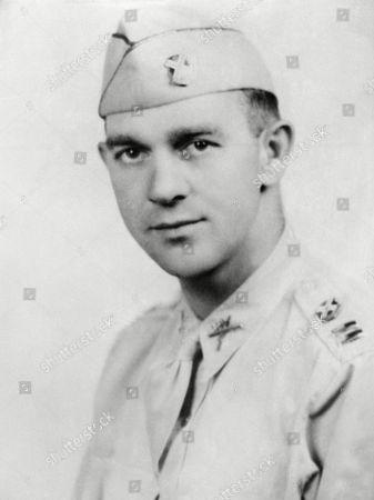 "Thomas D. Howie, of Stauton, Va., serving with the 116th Infantry, has been identified as the heroic ""Major of St. Lo"" who was killed in action, July 17, while leading his troops into the Normandy City, and whose flag-draped body was placed on a pile of rubble by a church as his men continued to fight on before it"