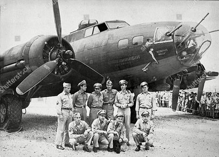 Quinlan Leighton Verinis Morgan The crew of the Memphis Belle, a Flying Fortress B-17F, poses in front of their plane in Asheville, N.C. Standing from left to right: tail gunner John P. Quinlan of Yonkers, N.Y.; nose gunner Charles B. Leighton of East Lansing, Mich.; co-pilot James Verinis of New Haven, Conn.; pilot Robert K. Morgan of Asheville, N.C.; bombardier Vincent Evans of Buellton, Calif.; radio operator Robert J. Hansen of Billings, Montana. Kneeling from left to right: waist gunner C.A. Nastal of Arlington Heights, Ill.; ball turret gunner Cecil H. Scott of Iselin, N.Y.; waist gunner C.E. Winchell of Barrington, Ill.; and navigator Harold P. Lock of Green Bay, Wisconsin. The most celebrated American aircraft to emerge from the great war rests these days in a cavernous hangar at a southern Ohio Air Force base undergoing a loving and fastidious restoration _ from its clear plastic nose cone down to the twin .50-caliber machine guns bristling in the tail