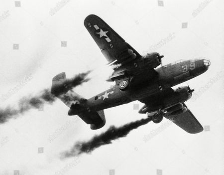 Stock Image of Flame and smoke spurt from rocket take-off units under the wings of this B-25 medium bomber as experiments are conducted at Wright Field, Oh., Headquarters of the Army Air Forces Material Command on . The rockets were originally developed to help lift heavy plane loads into the air from short, front-line runways. However, because short runways offer hazards for planes returning from a mission, some badly shot up, longer runways were planned at bases near the front, thereby eliminating the need for the new units. E