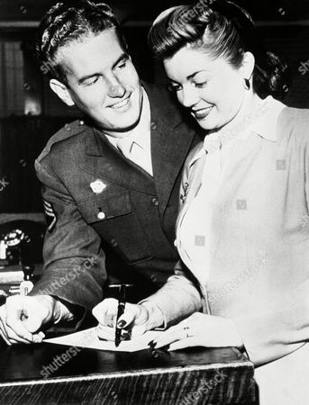 Esther Williams, famous American swimmer who has become a star of the film world, was married to Staff Sergeant Ben Gage, formerly radio announcer in the Bob Hope programme, at Berverly Hills, Ca. on . Esther Williams, signs a marriage application form at Los Angeles, California while Ben Gage watches