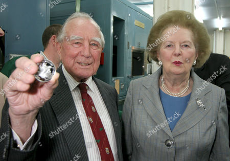 Former Governor of the Falkland Islands, Rex Hunt and Margaret Thatcher with two of the struck coins