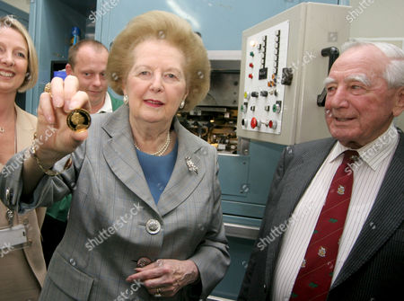 Stock Image of Margaret Thatcher with the gold crown coin and former Governor of the Falkland Islands, Rex Hunt