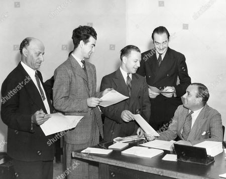 Charles Cumming, seated, receives the applications from four men at the British Consulate in New York, . The applicants were among those who sought to join the British Civilian Technical Corps as radio locators for civilian radio work in England