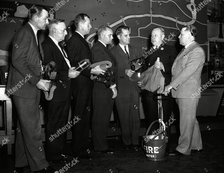 Arthur Wright Assistant Chief Arthur B. Wright of the New York City Fire Department, in charge of the fire college in Long Island City, N.Y., explains the use of special equipment used in fighting wartime fires to a group of Houston, Tex. Firemen who came to New York to study methods used in London. From left to right are Lt. J. P. Clooney; District Chief O. W. Heath, Capt. F. E. Jaynes, Capt. H. L. Matthews, Fire Commissioner F. E. Mann, Chief Wright, and Theodore Felds, Director of Harris County Emergency Corp