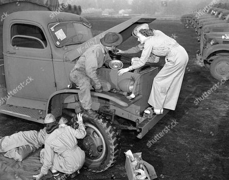"Teresa Whelan, Helen Corbin, Sgt. Lawrence Lovell, Jane Peterson and Julie Bellus were into this army truck's ""innards"" in no time flat when Sgt. Lovell, as their instructor, gave advice in car repair, in Fort Lewis, Wash., . To lift heavy objects from the truck for repairs there would be a mechanical crane which the girls could operate easily. When asked how they would like to have plenty of work on their hands, one girl replied, ""Oh, this is fun. Give us a broken down truck and we'll show you"