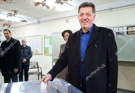 Stock Image of Algirdas Butkevicius Lithuania's Social Democrat party leader and Prime Minister Algirdas Butkevicius votes at a polling station during parliamentary elections in Vilnius, Lithuania, . Lithuanians are voting in an election that could see a change of government after four years of power by a ruling coalition led by the Social Democrats