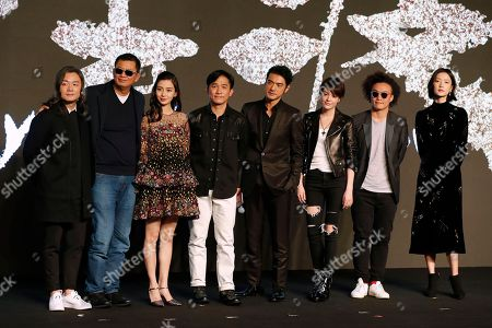 """Chinese director Zhang Jiajia, left, Hong Kong director Wong Kar-wai, second left, and actors, from third left, Hong Kong actress Angelababy, Hong Kong actor Tony Leung, Taiwan-Japanese actor Takeshi Kaneshiro, Taiwanese actress Sandrine Pinna, Hong Kong singer Eason Chan and Chinese model Du Juan pose for photographers during a press conference for their latest movie """"Ferryman"""" in Beijing, . The movie will open in China on Dec. 23"""