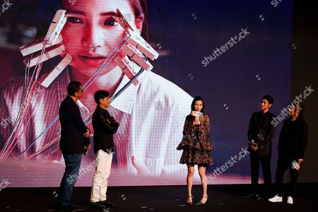 """Hong Kong actress Angelababy, center, talks about her character in the movie as Chinese director Zhang Jiajia, right, Hong Kong director Wong Kar-wai, left, Hong Kong actor Tony Leung, second left, Taiwan-Japanese actor Takeshi Kaneshiro, second right, listen to her during a press conference for their latest movie """"Ferryman"""" in Beijing, . The movie will open in China on Dec. 23"""