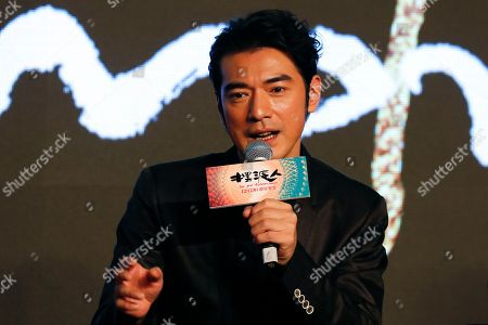 """Taiwanese-Japanese actor Takeshi Kaneshiro speaks during a press conference for his new movie """"Ferryman"""" in Beijing, . The movie will open in China on Dec. 23"""