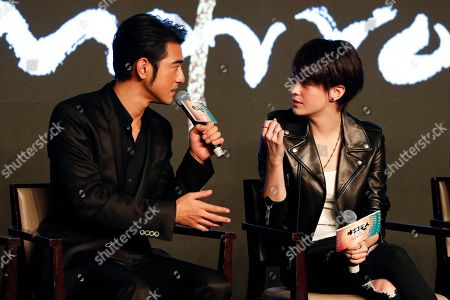 """Taiwanese-Japanese actor Takeshi Kaneshiro, left, chats with Taiwanese actress Sandrine Pinna during a press conference for their new movie """"Ferryman"""" in Beijing, . The movie will open in China on Dec. 23"""
