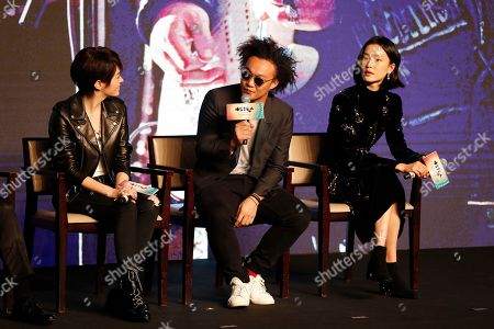 """Hong Kong singer Eason Chan, center, speaks next to Taiwanese actress Sandrine Pinna, left, and Chinese model Du Juan during a press conference for their new movie """"Ferryman"""" in Beijing, . The movie will open in China on Dec. 23"""
