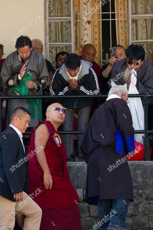 Devotees welcome Tibetan spiritual leader the 17th Karmapa Ogyen Trinley Dorje as he arrives to preside over founding anniversary celebrations at the Tibetan Children's Village School in Dharmsala, India, . The school, which started as an orphanage in 1960, houses and educates over a thousand refugee Tibetan children