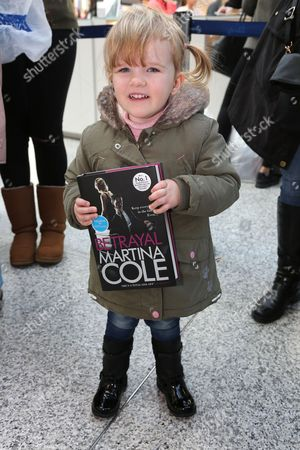 Young fan with Martina Cole's new book 'Betrayal'