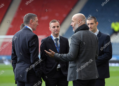 Former referee Howard Webb (2nd from right) talks to the officials before kick off during the Betfred Scottish League Cup semi final match between Rangers and Celtic played at Hampden Park, Glasgow on 23rd October 2016