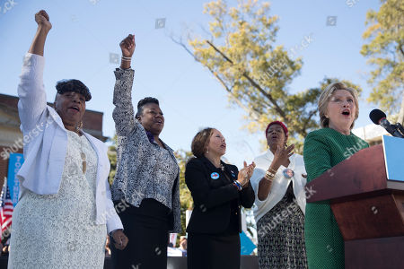 Hillary Clinton Gwen Carr, left, mother of Eric Garner, Sybrina Fulton, second from left, mother of Trayvon Martin, Lucia McBath, second from right, mother of Jordan Davis, and Maria Hamilton, mother of Dontre Hamilton, cheer as Democratic presidential candidate Hillary Clinton speaks during a campaign event at The Quad, Saint Augustine's University, in Raleigh, N.C
