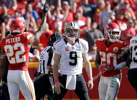 Marcus Peters, Drew Brees, Steven Nelson New Orleans Saints quarterback Drew Brees, center, stands between Kansas City Chiefs defensive backs Marcus Peters (22) and Steven Nelson (20) after the final play of an NFL football game, in Kansas City