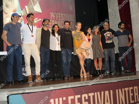 "The cast and crew of the film ""Un cuento de circo & a Love Song"" pose for a portrait after a press conference. From left are director Demian Bichir, actor Hasiff Fadul, actor Bruno Bichir, producer Araceli Velazquez, producer Santiago Garcia Galvan, actress Stefanie Sherk, actress Arcelia Ramirez, actress Ludwika Paleta and actor Jose Angel Bichir. The film is the directorial debut Demian Bichir, an Oscar nominated actor who has starred films such as ""A Better Life"" and ""The Hateful Eight"