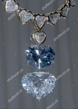 Stock Picture of NECKLACE BEGUM BLUE A Geneva court rejected a last-minute appeal from Prince Karim Aga Khan IV Friday, clearing the way for his former wife to auction off $15 million worth of jewels. The bulk of the jewels, including this deep-blue, heart-shaped diamond of 13.78 carats called the ''Begum Blue,'' will be included in the auction. Begum is the title of the wife of the Aga Khan. The diamond is in a necklace of 40 other heart-shaped diamonds expected to fetch more than $10 million