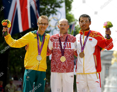 Gold-medallist Sergei Kirdyapkin of Russia, center, stands with silver-medallist Jared Tallent of Australia, left, and bronze-medallist Si Tianfeng of China after the men's 50-kilometer race walk competition at the 2012 Summer Olympics in London. Nearly four years late and half a world away from London, Australian race walker Jared Tallent finally received his chance to move up another rung on the Olympic medal podium. This time it was for a gold medal, which was stripped from Sergei Kirdyapkin of Russia. On, Tallent was presented with the gold medal by International Olympic Committee vice-president John Coates in a ceremony held in drizzly rain in front of the Old Treasury Building in Melbourne