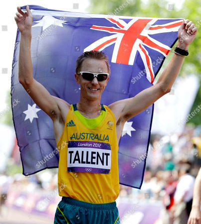 FILE - In this Aug. 11, 2012 photo, Australia's Jared Tallent celebrates taking the silver medal in the men's 50-kilometer race walk at the 2012 Summer Olympics in London. Nearly four years late and half a world away from London, Australian race walker Jared Tallent finally received his chance to move up another rung on the Olympic medal podium. This time it was for a gold medal, which was stripped from Sergei Kirdyapkin of Russia. On, Tallent was presented with the gold medal by International Olympic Committee vice-president John Coates in a ceremony held in drizzly rain in front of the Old Treasury Building in Melbourne