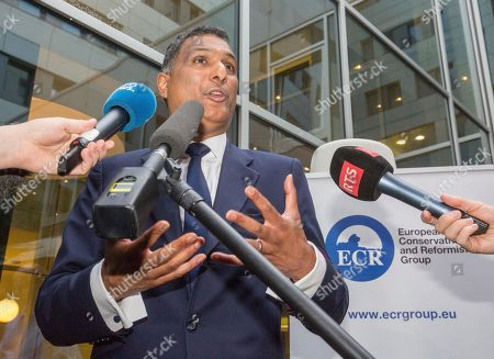 Leader of the European Conservatives and Reformists Syed Kamall speaks in Brussels on . Britain entered uncharted waters Friday after the country voted to leave the European Union, according to a projection by all main U.K. broadcasters
