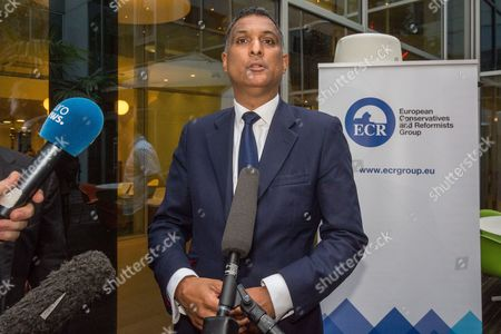 Leader of the European Conservatives and Reformists Syed Kamall of Britain, speaks in Brussels on . Britain entered uncharted waters Friday after the country voted to leave the European Union, according to a projection by all main U.K. broadcasters