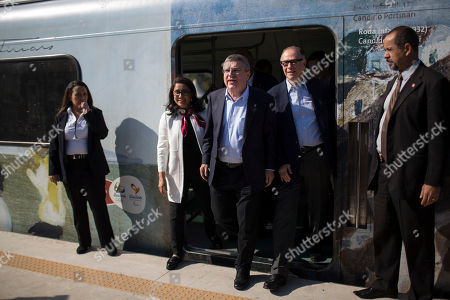 Stock Image of IOC President Thomas Bach, center, Brazil Olympic Committee President Carlos Arthur Nuzman, right, and head of the International Olympic Committee's evaluation commission Nawal El Moutawakel, exit a train on their way to the Deodoro Olympic Complex in Rio de Janeiro, Brazil, . Rio will host the Olympic games starting on Aug. 5, amid the worst recession to hit Brazil in decades, an outbreak of the Zika virus and the ongoing political crisis that saw President Dilma Rousseff impeached and suspended from office