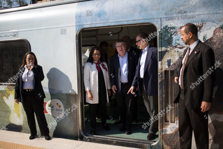 IOC President Thomas Bach, center, Brazil Olympic Committee President Carlos Arthur Nuzman, right, and head of the International Olympic Committee's evaluation commission Nawal El Moutawakel, exit a train on their way to the Deodoro Olympic Complex in Rio de Janeiro, Brazil, . Rio will host the Olympic games starting on Aug. 5, amid the worst recession to hit Brazil in decades, an outbreak of the Zika virus and the ongoing political crisis that saw President Dilma Rousseff impeached and suspended from office