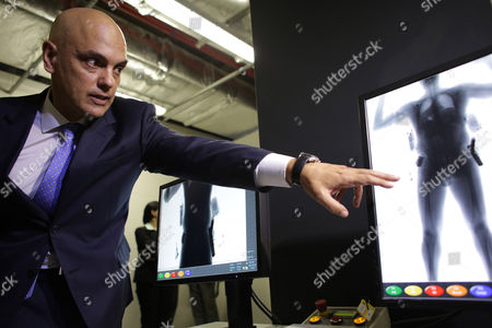 "Alexandre de Moraes Brazil's Justice Minister Alexandre de Moraes points to the screen of a body scanner, during an inspection of safety procedures for the Rio 2016 Olympic Games, at the International Airport in Brasilia, Brazil. Moraes surprised many last week by saying the chances of a terror attack at the games were ""next to zero"" and that the bigger concern is street crime. Just a day later, the federal police overseen by Moraes arrested 10 Brazilians allegedly belonging to an amateur cell that had professed allegiance to ISIS over the internet"