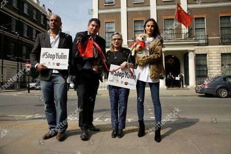 Stock Photo of U.S. actress Carrie Fisher, second right, with her dog Gary being held by Labour party MP Rob Flello, second left, model and reality television celebrity Lucy Watson, right, with her dog Digby, and television vet Marc Abraham pose for photographers before trying to hand a petition against China's Yulin dog meat festival to the Chinese Embassy in London, . Animal rights activists are seeking to shut down an annual summer dog meat festival in southern China blamed for blackening the country's international reputation as well as fueling extreme cruelty to canines and unhygienic food handling practices
