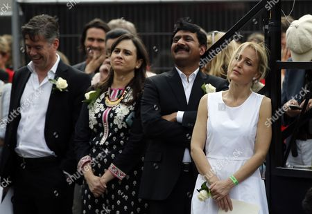 "Actor Gillian Anderson, right, and Ziauddin Yousafzai, father of Malala Yousafzai, listen to her speech during a gathering to celebrate the life of murdered British MP Jo Cox, in Trafalgar Square, London, . Jo Cox, a 41-year-old Labour lawmaker who had championed the cause of Syrian refugees, was stabbed and shot to death outside a library in her northern England constituency on Thursday. The suspect gave his name in court as ""death to traitors, freedom for Britain"