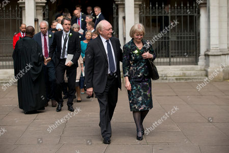 Glenys Kinnock, who gave a reading, and her husband and former Labour Party leader Neil Kinnock leave St Margaret's Church in London, after a service of prayer and remembrance to commemorate Jo Cox, the 41-year-old Member of Parliament fatally shot last week in northern England, . The mother of two was shot on Thursday afternoon in her constituency near Leeds. The man charged with her slaying made a brief appearance in court by video link from prison Monday