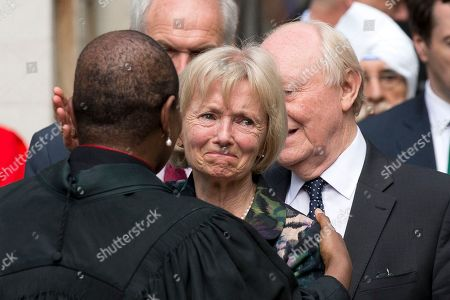 Stock Picture of Glenys Kinnock, who gave a reading, and her husband and former Labour Party leader Neil Kinnock, right obscured, speak to the Speaker's Chaplain, the Reverend Rose Hudson-Wilkin, left, as they leave St Margaret's Church in London, after a service of prayer and remembrance to commemorate Jo Cox, the 41-year-old Member of Parliament fatally shot last week in northern England, . The mother of two was shot on Thursday afternoon in her constituency near Leeds. The man charged with her slaying made a brief appearance in court by video link from prison Monday