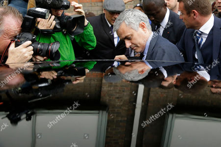 Former manager of Chelsea soccer team and current manager of Manchester United Jose Mourinho, centre, gets into a car as he leaves after attending an employment tribunal for former Chelsea team doctor Eva Carneiro at the Croydon Employment Tribunal in Croydon, south London, . Chelsea has reached a settlement with its former club doctor at the start of an employment tribunal, details were not disclosed Tuesday