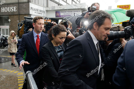 Former Chelsea team doctor Eva Carneiro, centre, leaves with her husband Jason De Carteret, right, at the end of her employment tribunal at the Croydon Employment Tribunal in Croydon, south London, . Chelsea has reached a settlement with its former club doctor at the start of an employment tribunal, details were not disclosed Tuesday