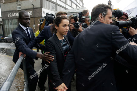 Former Chelsea team doctor Eva Carneiro, centre, holds the hand of her husband Jason De Carteret as she leaves at the end of her employment tribunal at the Croydon Employment Tribunal in Croydon, south London, . Chelsea has reached a settlement with its former club doctor at the start of an employment tribunal, details were not disclosed Tuesday