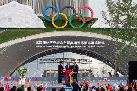 Stock Photo of International Olympic Committee (IOC) President Thomas Bach, center, shakes hands with Beijing Mayor Wang Anshun, left, as Liu Peng, right, Minister of the General Administration of Sport of China looks on after the inauguration of the Beijing Olympic Tower and Olympic Symbol in Beijing, . Beijing will host the Winter Olympics in 2022