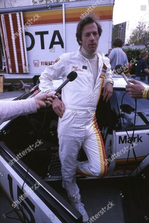 UKCOL Mark Thatcher, son of British Prime Minister Margaret Thatcher, is interviewed next to his Peugot 504 car, prior to competing in the Paris Dakar Rally, Paris, France, 1982. Thatcher, his French co-driver Charlotte Verney and their mechanic, went on to break down during the rally, and were missing in the Sahara Desert for six days before being found