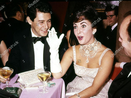 British actress Elizabeth Taylor jokes with husband Eddie Fisher during a party at Leone's restaurant in New York City, Nov. 1959. Exact date unknown