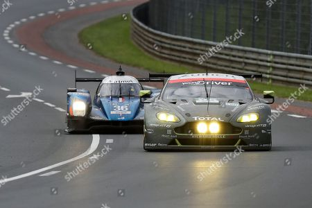 The Aston Martin Vantage No95 of the Aston Martin Racing team driven by Nicki Thiim, Marco Sorensen of Denmark and Darren Turner of Great Britain followed by the Alpine A460 Nissan of the Signatech Alpine team driven by Gustavo Menezes of the U.S, Nicolas Lapierre of France and Stephane Richelmi from Monaco during the 84th 24-hour Le Mans endurance race, in Le Mans, western France