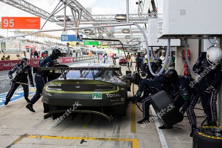 Mechanics repair the Aston Martin Vantage No95 of the Aston Marton Racing team driven by Nicki Thiim, Marco Sorensen of Denmark and Darren Turner of Great Britain during the 84th 24-hour Le Mans endurance race, in Le Mans, western France