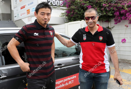 Japan's rugby player Ayumu Goromaru, left, arrives with RCT team owner Mourad Boudjellal for a press conference at the Mayol stadium of Toulon, southern France, . The 30-year-old signed to Toulon on a one-year contract with a 12 month extension as an option